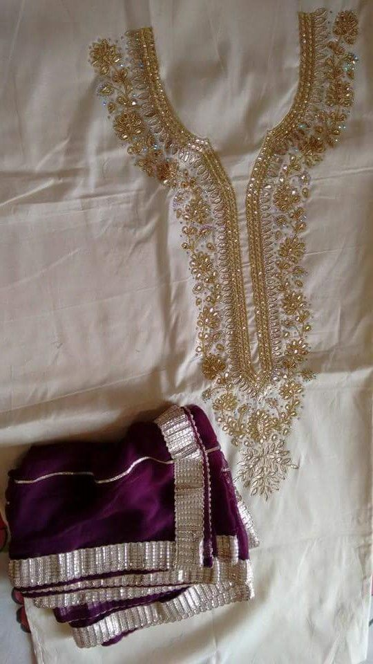 Hand Embroidered Pure Creap Suit in Cream Color With Violet Contrast