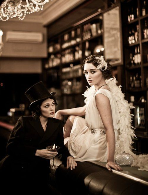 Great Gatsby fashion- with the right materials the simple white dress would be quite easy tom make I think, the feather boa and the head dress and pearls make it perfect for the time.