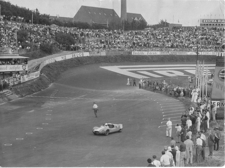 Spectators and a lonely car
