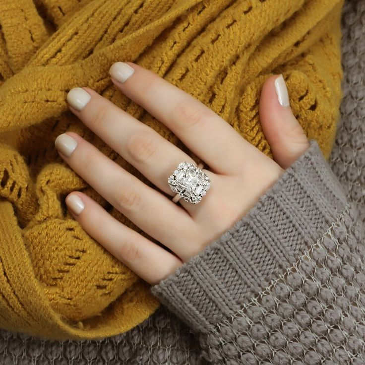 Your New Year's resolution: Get this halo art deco ring! Enhanced with romantic linear cuts and bold geometric shapes, this Victorian style statement-maker is a beautiful rendition of the Art Deco movement. See what others are saying about this fan favorite.