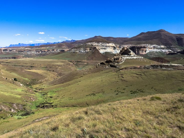 Distant - Golden Gate Highlands National Park is located in Free State, South Africa, near the Lesotho border. The park's most notable features are its golden, ochre, and orange-hued deeply eroded sandstone cliffs and outcrops, especially the Brandwag rock.