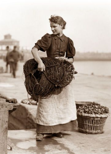 Fisher woman, Whitby, England.  That net would have been very heavy!  Taken by…