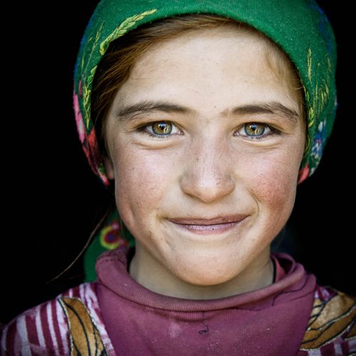 """What is it you want to change?/Your hair, your face your body?/Why?/For God is in love with all these things/and He might weep when they are gone."" St. Catherine of Siena (smiling girl, Kyrgyzstan)"