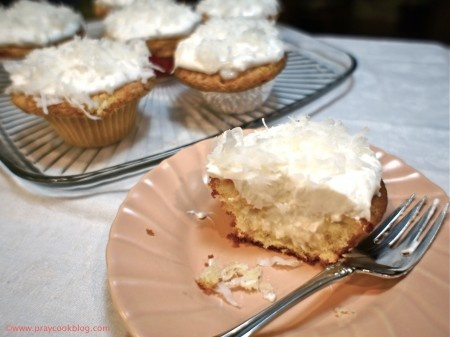 Yummy filled sour cream coconut cupcakes.