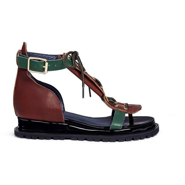 Sacai Lace-up cowhide and patent leather wedge sandals ($885) ❤ liked on Polyvore featuring shoes, sandals, wedge heel sandals, lace-up sandals, patent shoes, patent leather sandals and laced shoes