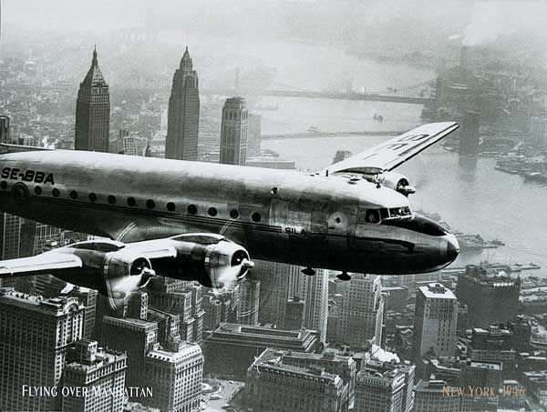 Unknown aircraft flying over city 1946 art prints and posters