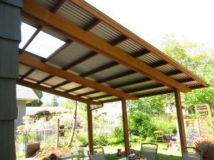 Swoopy Patio Roof --Big 16x18 foot roof covers back patio  --Sturdy 4x6 posts support long double beams  --Satin-finished steel roof includes clear skylight