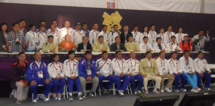 On July 29, President Elbegdorj came to visit the Olympic Village (ctr of the middle row) and posed with the team in the Chef de Mission meeting hall.