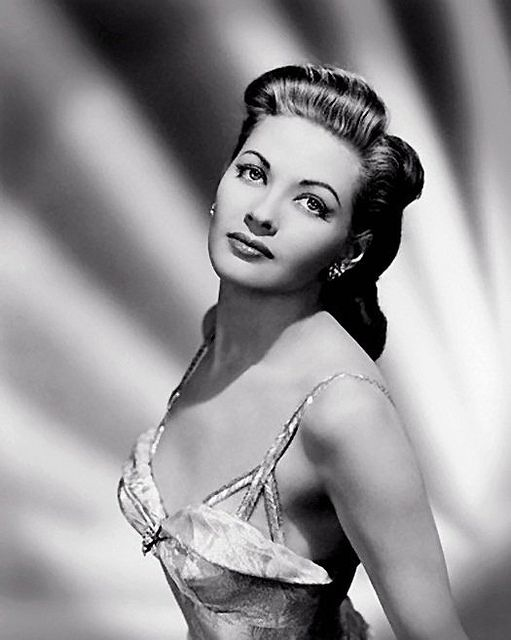 Yvonne De Carlo - better known as Lily Munster. She pretty much sets the standard...