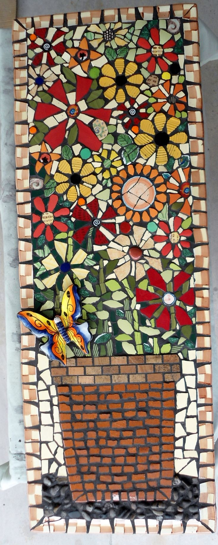 Long mosaic picture of flowers in a pot and a 3D butterfly. www.etsy