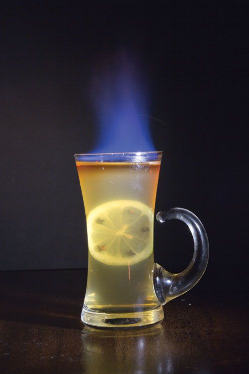 Colts Neck Toddy    1 oz. apple brandy, such as Laird's   ½ oz. fresh lemon juice  ½ oz. maple syrup  ½ oz. Cardamaro (available at Astor Wine & Spirits)  ⅛ oz. decanter bitters, preferably Bitter Truth Jerry Tomas' Own (available at Chelsea Wine Vault)  1 slice lemon  5 whole cloves  ½ oz. barrel-strength bourbon, preferrably George T. Stagg (available at Twenty Twenty Wine Merchants)    INSTRUCTIONS  In a tempered-glass mug, stir together brandy, juice, syrup, Cardamaro, bitters, and 3