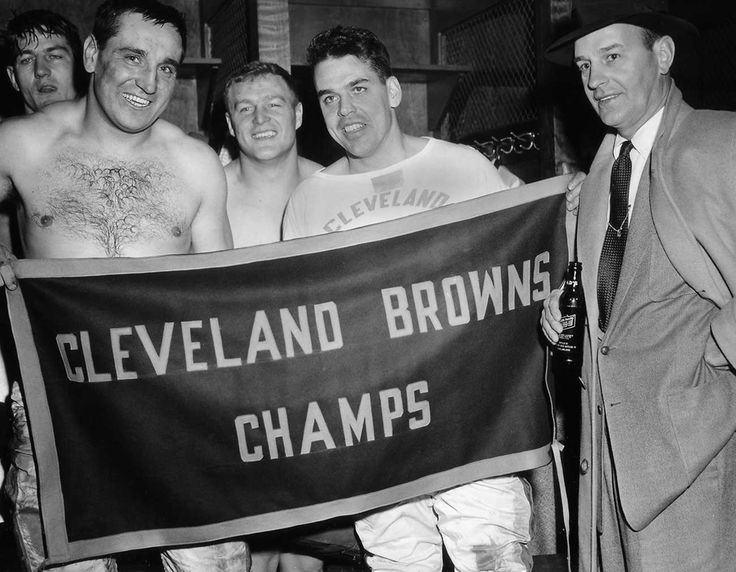 Pete Brewster, Lou Groza, Chuck Noll, Otto Graham and Paul Brown celebrate Cleveland's 1954 NFL championship.