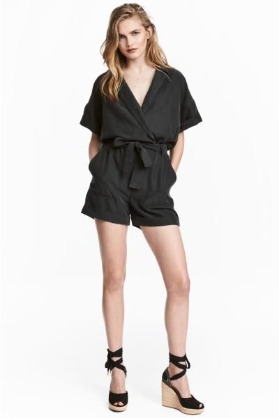 Playsuit in a soft modal blend with a matt silk finish. Wrapover front with a concealed press-stud, an elasticated seam with detachable wide tie belt at the