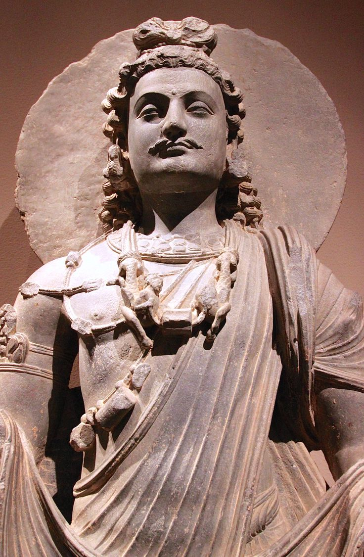 This bodhisattva, ca 3rd century, can be identified as Maitreya by the lip of the sacred water flask in his left hand and by his loop topknot, a hairstyle common to Maitreya images. On the base, donor figures venerate a Buddhist reliquary that rests on a low throne under a canopy. Pakistan (ancient region of Gandhara) Medium: Gray schist Dimensions: H. 64 1/4 in. (163.2 cm) Purchase, Lita Annenberg Hazen Charitable Trust Gift, 1991. Metropolitan Museum of Art N.Y. Photo by Eros Greatti.