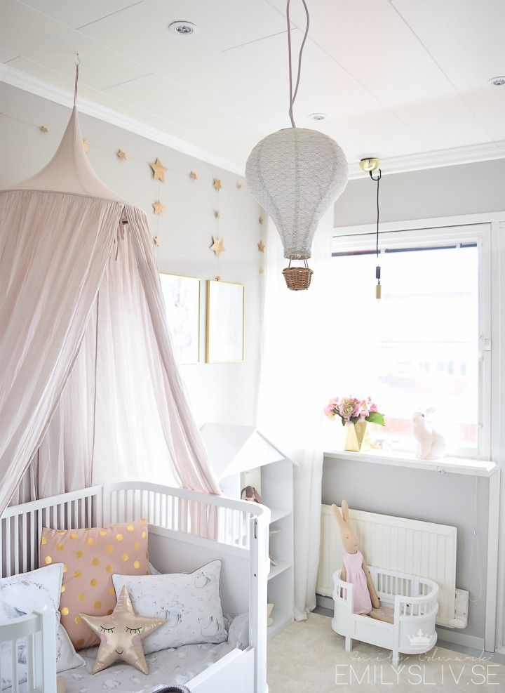 Girls pastel dream room with bed canopy