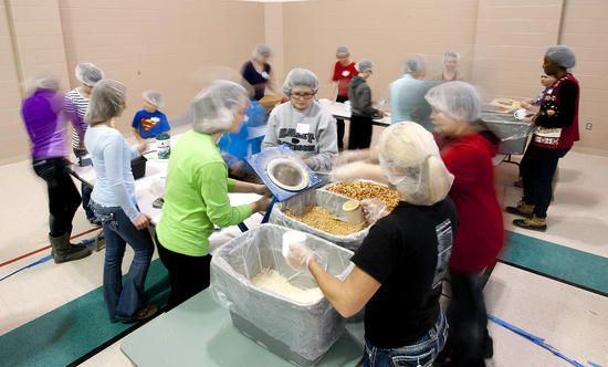 The Feed My Starving Children MobilePack event Sunday, Dec. 8, at the Osage Centre in Cape Girardeau. Organized by La Croix United Methodist Church in Cape Girardeau, 2,769 volunteers from numerous area churches and organizations packed 723,168 meals that will be shipped to malnourished children in countries all over the world by the not-for-profit Christian organization.