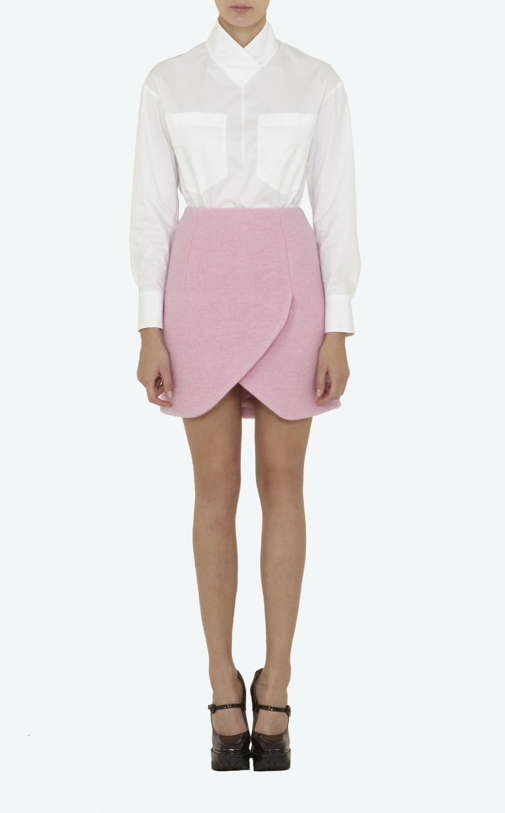 Carven refers to this as a 'tulip skirt'; I think of it as a modernized kilt. Either way, I cannot deny that it is the thought of wearing this perfect shade of pink in winter that most appeals to me, no matter how its design is classified. Women's crushed wool tulip skirt in #pink by Carven - carven.fr