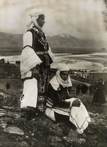 Epirus, GREECE. Women in ornate embroidered and lace costume pose on a hillsi 1910S Epirus, Greece. Photographer: HENRY RUSCHIN/National Geographic Creative