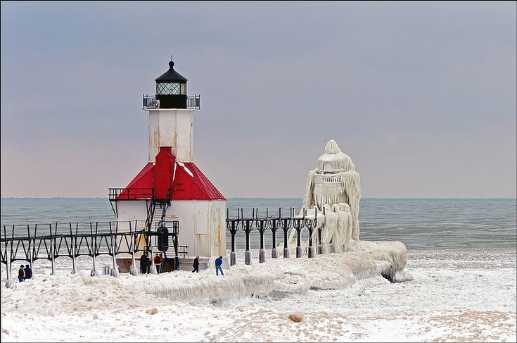 Located on Lake Michigan is the St. Joseph North Pier (google maps), which features two lighthouses ('Outer' and 'Inner') that were both built over a century ago. When the wind picks up during Michigan's frosty winter months, large waves crash upon the pier and lighthouses, creating beautiful ice formations only nature is capable of.