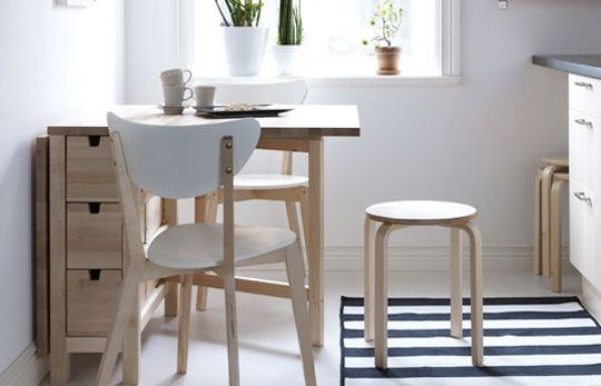I think I found a kitchen table winner! - Ikea table converts from counter into table that can seat 2 or 4. Includes storage for cutlery.
