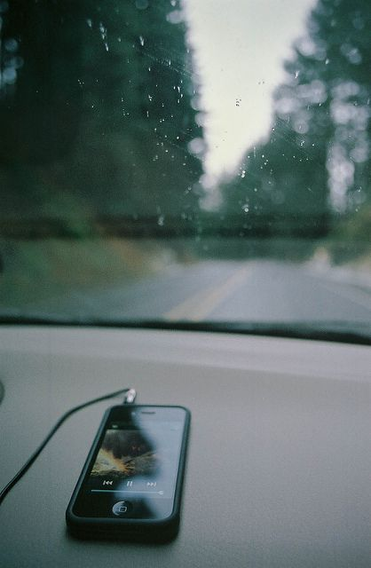 driving alone on a rainy day, all she had was herself, her always changing music and her loved and trusted car.