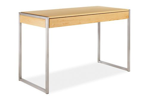 $1,099.00.  When the pullout work surface is closed, the Basis desk is the perfect console table. Either way, the interplay of solid wood and hand-welded stainless steel creates a desk you'll love. The deep drawer stores paperwork as well as your laptop.  50x22