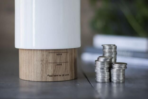 Elegant redesigned piggy bank rises up to show how much is saved inside