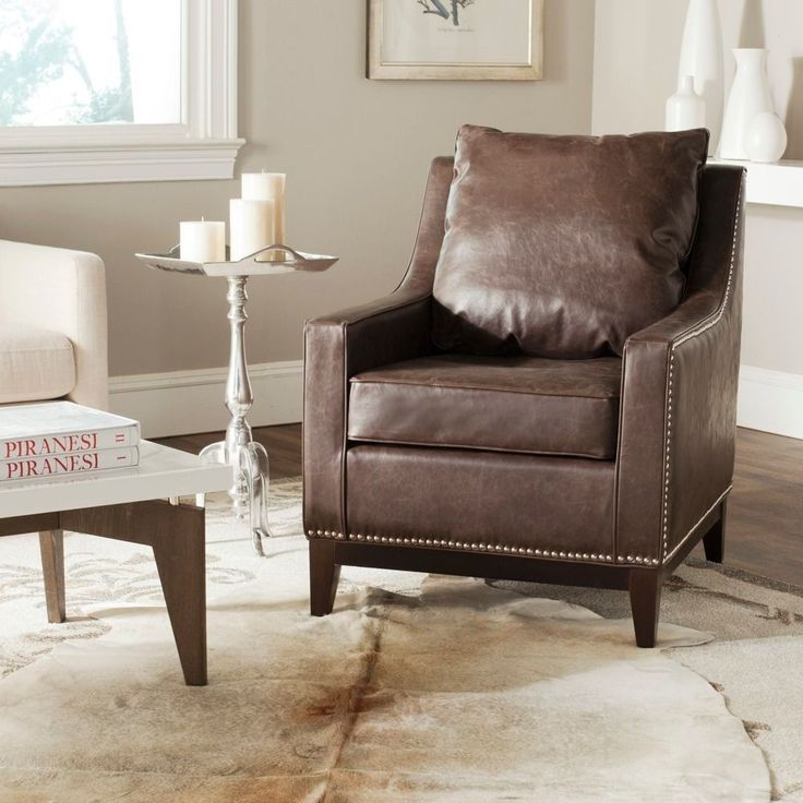 Gently sloped arms infuse the Colton club chair from Safavieh with a relaxed, inviting appeal.