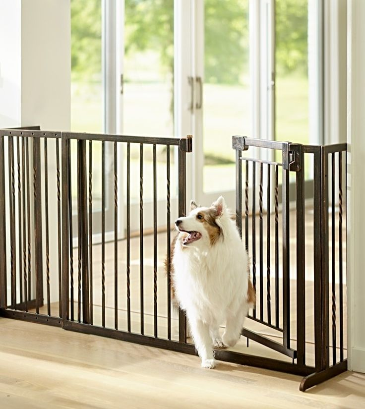 "Our 34""H Freestanding Pet Barrier with with Walk-through Door provides a contemporary, stylish alternative to plain metal pet gates."