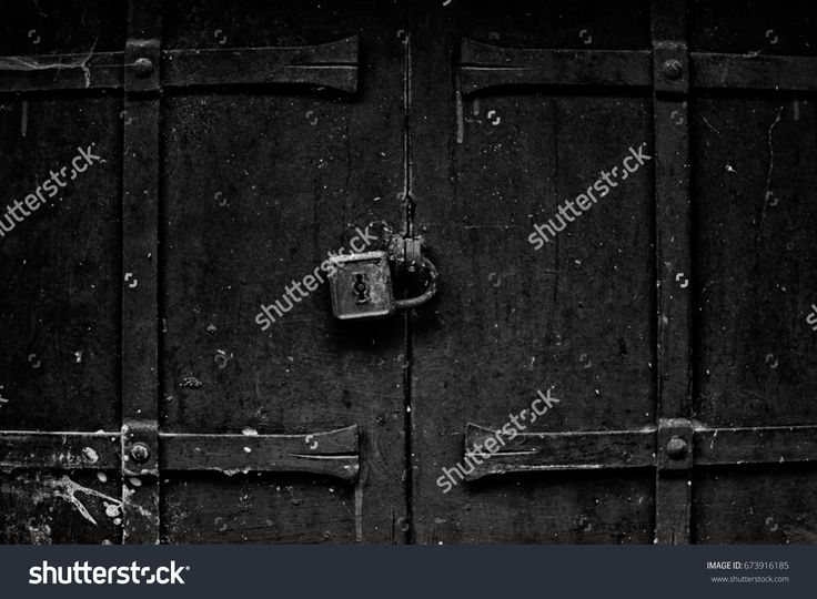 Old door, locked with padlock