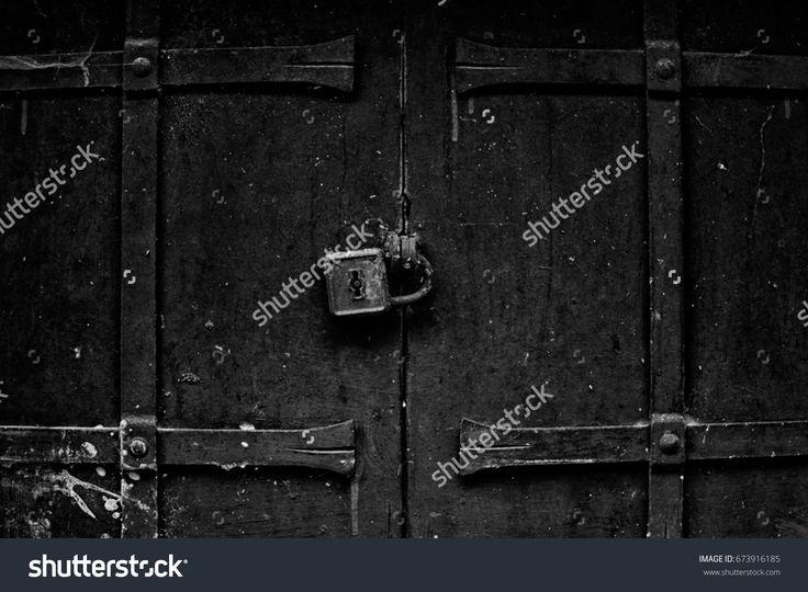 Old door, locked with padlock