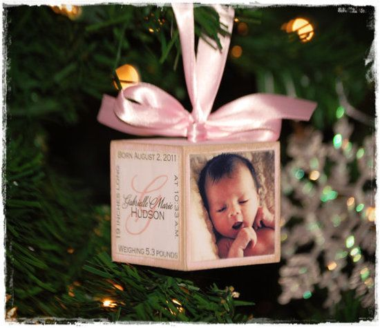 Custom Picture Ornament : What better way to commemorate the special holiday than with pictures? This baby's first Christmas ornament ($20) lets you customize each side of the block with photos and birth information.