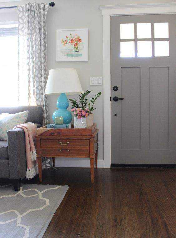 Home Tour: My Living Room — Chic Little House. Grey Interior Front Door, Pretty Lamps, Vintage side table & Minter Artwork, layered in colors and texture