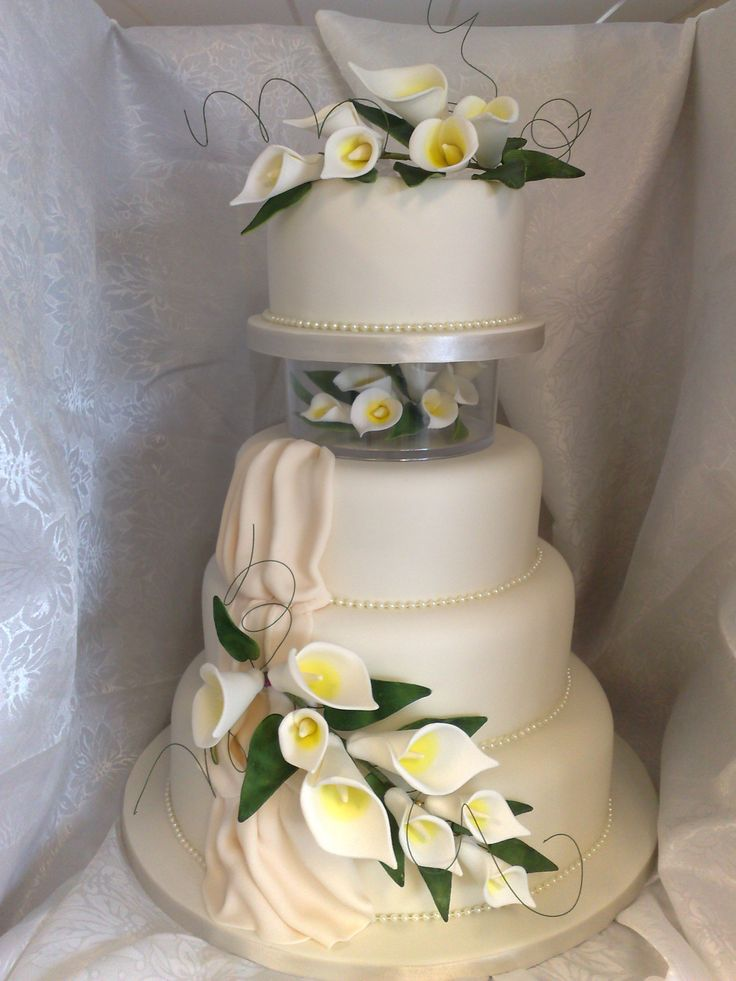 The 94 best sugarcraft supplies cake decorating shop tuition white four tier wedding cake with drape acrylic seperator and decorative white arum lily sugarflowers junglespirit Gallery