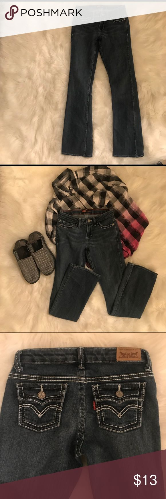 Levi's Boot Cut Girls Bootcut Jeans 👖 These jeans have no real signs of wear and tear and are super cute on! These even have the much loved adjustable waist (shown in pic). Slender in the hips and thighs but made to wear with your boots or tennis shoes! Your special girl will love these! Levi's Bottoms Jeans