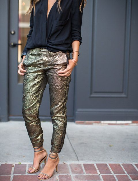 Pair metallic pants with silky tops.  Really, anything shiny wins. Temper the rest of the outfit with a dark draped blouse and minimal heels.