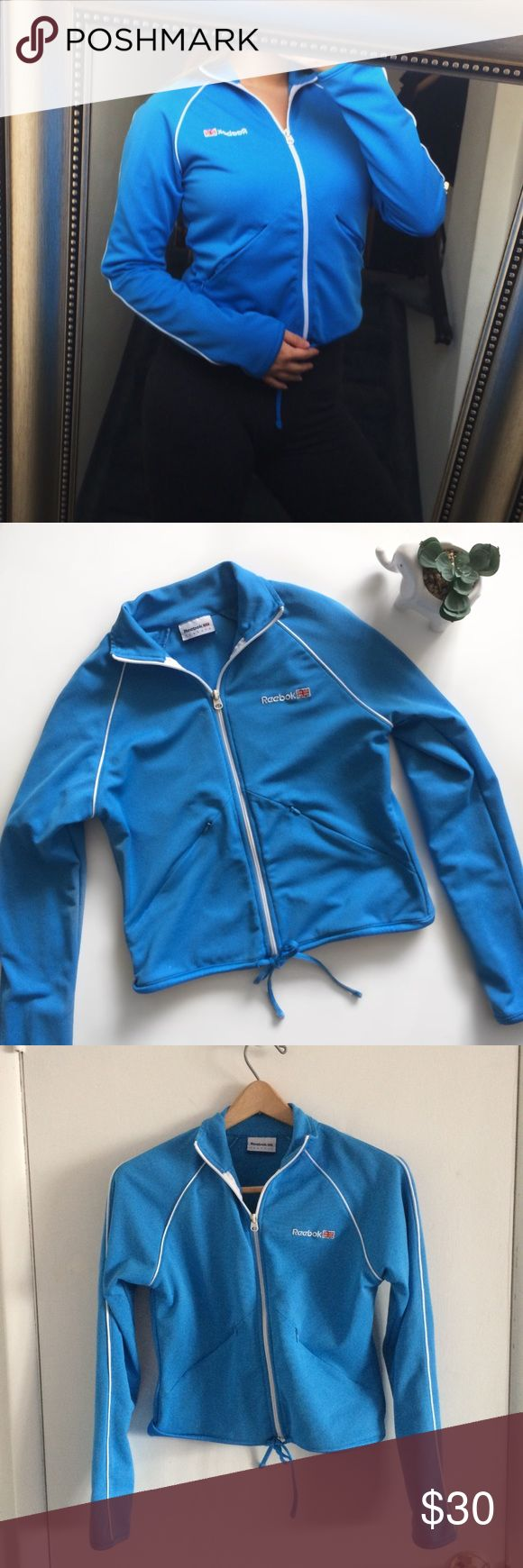 "Reebok Classic Blue Zip Up Athletic Jacket Vintage Reebok Classic Blue and White Lined Jacket. Size and materials label has been cut off. Fits XS/S.  Measurements laying flat (approx):    *17""in pit to pit    *19""in length    *26.5""in sleeve length (from collar to end of sleeve hem) Reebok Jackets & Coats"