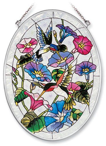 Amia Hand Painted Glass Suncatcher with Hummingbird and Morning Glory Design, 5-1/4-Inch by 7-Inch Oval by Amia. $19.00. Includes chain. Comes boxed, makes for a great gift. Handpainted glass. Amia glass is a top selling line of handpainted glass decor. Known for tying in rich colors and excellent designs, Amia has a full line of handpainted glass pieces to satisfy your decor needs. Items in the line range from suncatchers, window decor panels, vases, votives and much more.