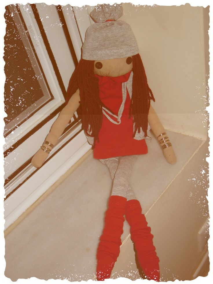 A doll for my daughter! In red and grey at the window!
