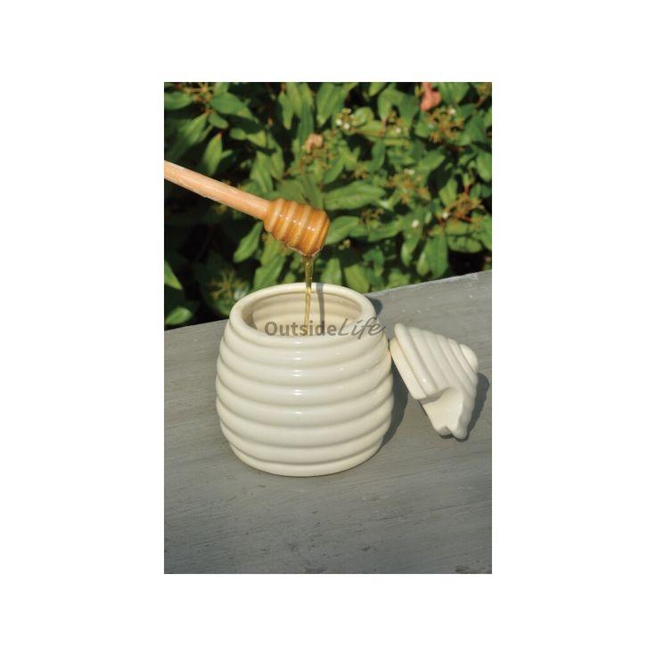 Honingpot met honinglepel. Honinglepel naar eeuwenoud ontwerp. Door deze honinglepel al draaiende ui [...]