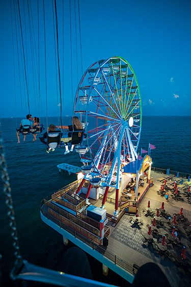 The Ferris wheel above the sea in Galveston, Texas. (Photo © Jake Meharg)