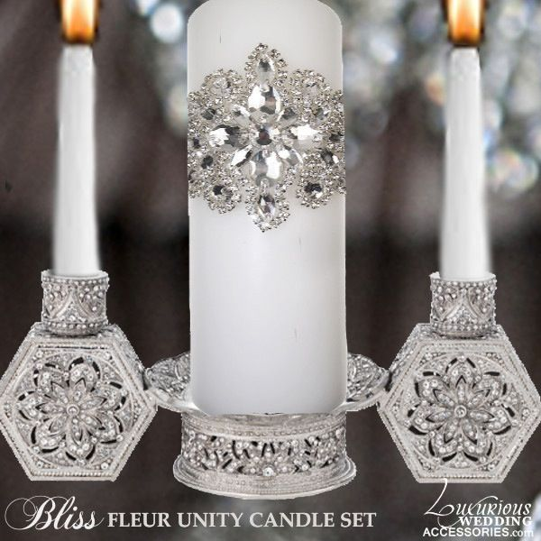 "The Bliss Fleur Candle Set from Luxurious Home Accents is one unit made with hundreds of hand-set clear Swarovski Crystals that have been cast pewter with a silver tone metal finish. (Candles Not Included) 10.5""L x 4.5""W x 4""H"