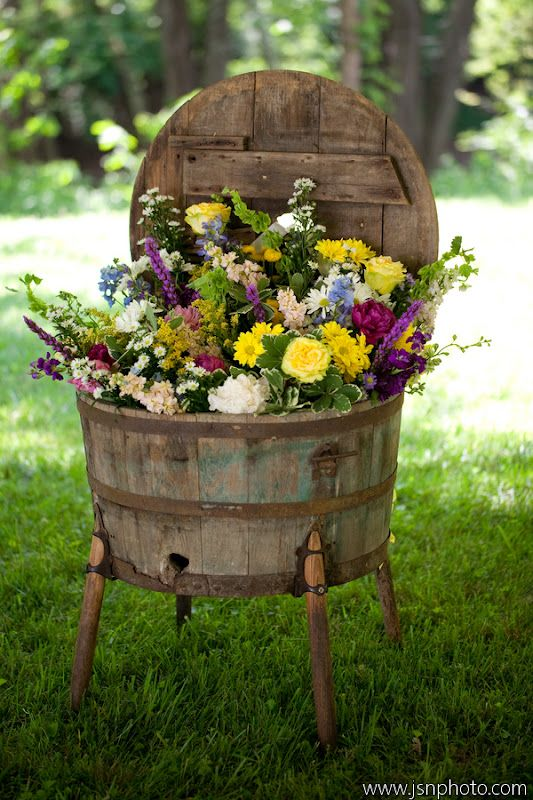 Old Rustic Barrel Planter..stuffed with flowers. Perfect for a wine country wedding ceremony/reception
