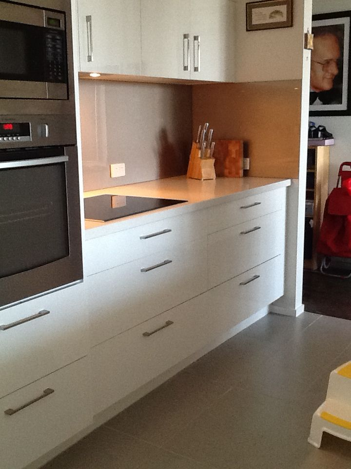 Oven,,induction cooktop and bench with LED lighting