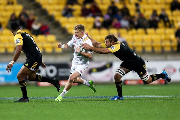 Callum Gibbins Photos Photos - Damian McKenzie of the Chiefs is tackled by Callum Gibbins of the Hurricanes during the round 16 Super Rugby match between the Hurricanes and the Chiefs at Westpac Stadium on June 9, 2017 in Wellington, New Zealand. - Super Rugby Rd 16 - Hurricanes v Chiefs