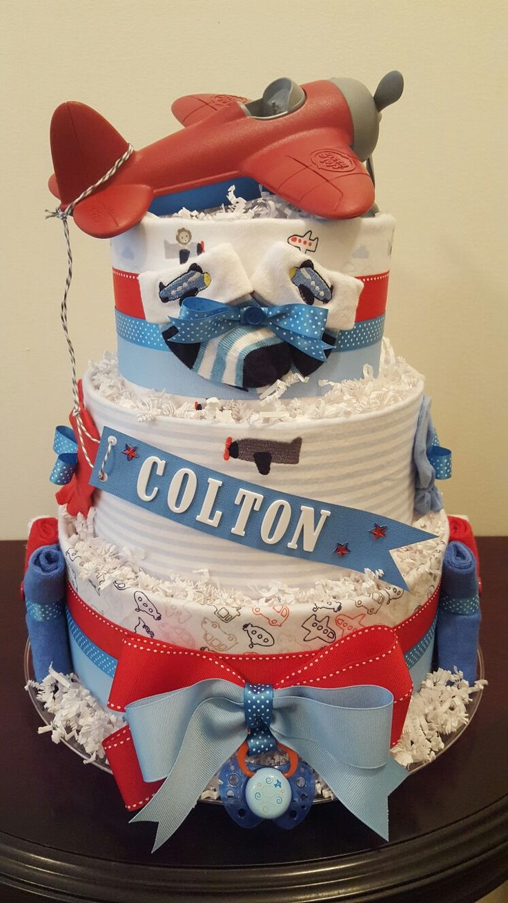 Airplane themed diaper cake! Airplane baby shower centerpiece gift! Visit my Facebook page Simply Showers for more pics and orders.  Created by Kim Swinson