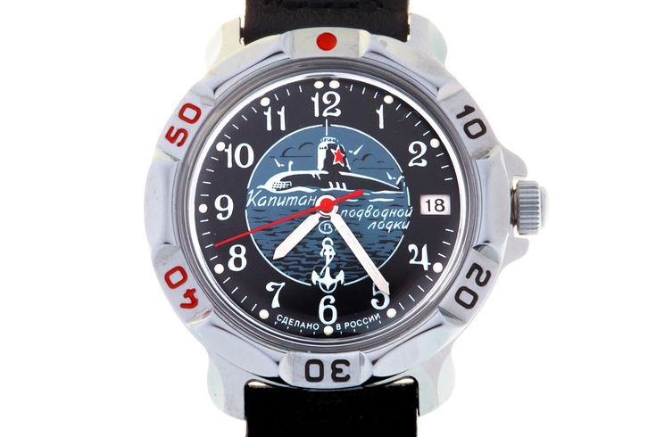 "WATCH VOSTOK KOMANDIRSKIE 811831 SUBMARINE CAPTAIN. In the center of the black watch face there is a round medallion with the image of a nuclear submarine with a red five-pointed star on the cabin, going on the waves and surrounded by seagulls. The inscription on the medallion reads ""Captain of a Submarine"". #russian #mechanical #military #watches #vostok #komandirskie #gifts #souvenirs #anchor #submarine"
