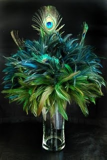 peacock centerpiece with feathers for mardi gras