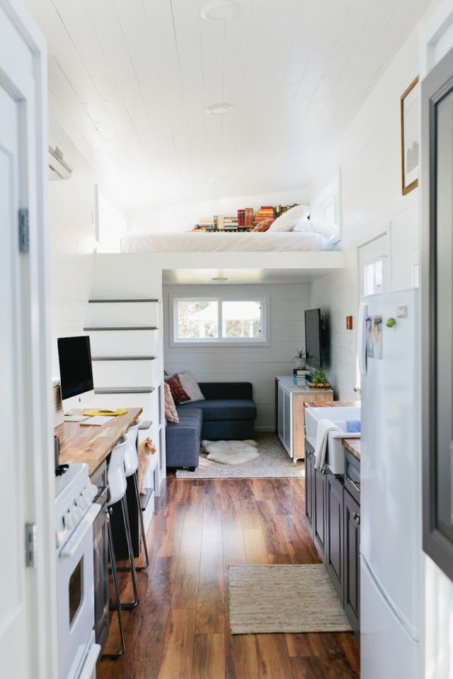 Add skylight above bed, slide out dining for two, open kitchen shelving, maximize under stair storage, change up second loft?