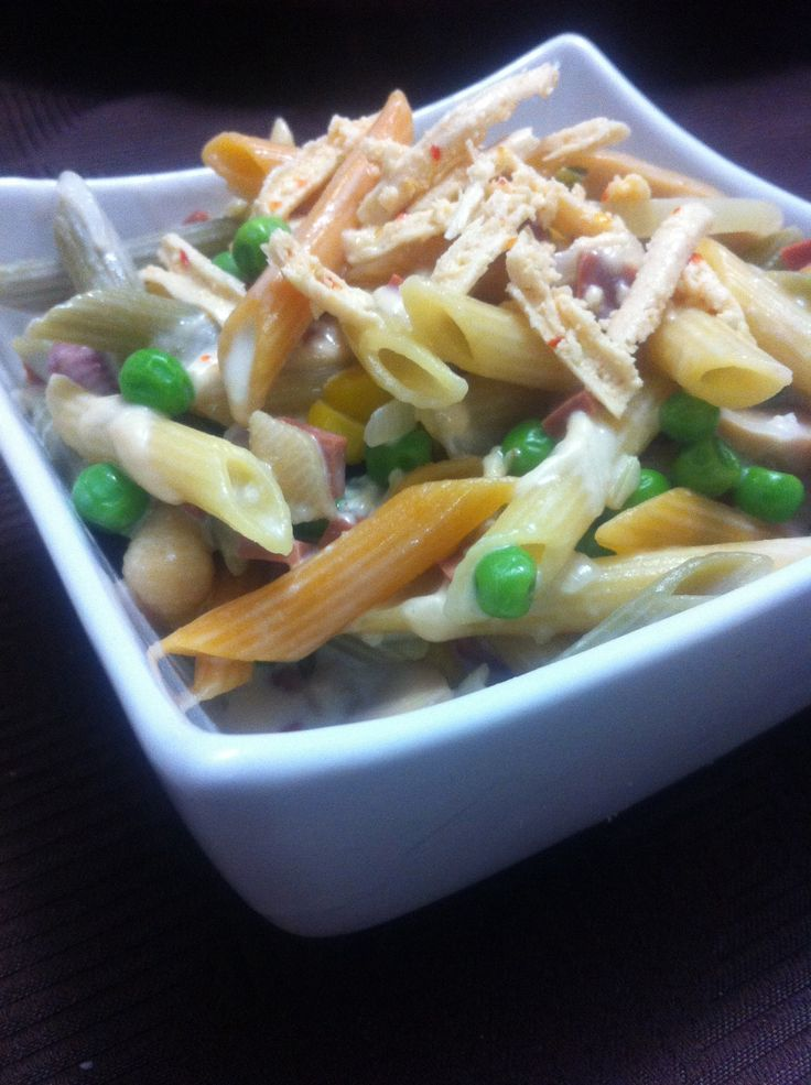 ... pasta in a white sauce with mushrooms, peas, corn and 'bacon' bits